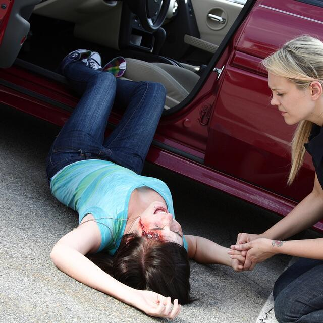 Car Accident Injury Specialist in Englewood, Florida helping a woman after a wreck