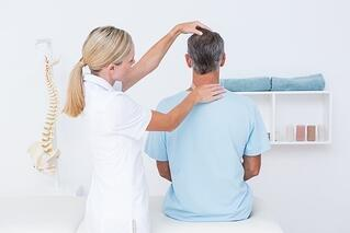 Chiropractor gives patient a neck adjustment