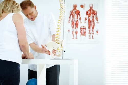 Punta Gorda, FL Car Wreck Physician talking to a patient about low back pain