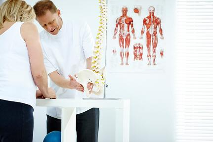 Car Wreck Doctor in Venice, Fl explaining low back injuries to a patient