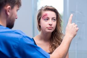 Car Accident Injury Doctor in Punta Gorda, Florida checking patient for concussion symptoms
