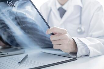 Chiropractor looking over x-rays of a car accident injury in Ocala
